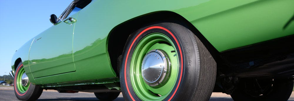 1969 Plymouth Road Runner with Firestone Wide Oval Redline Tires from Coker Tire Company.