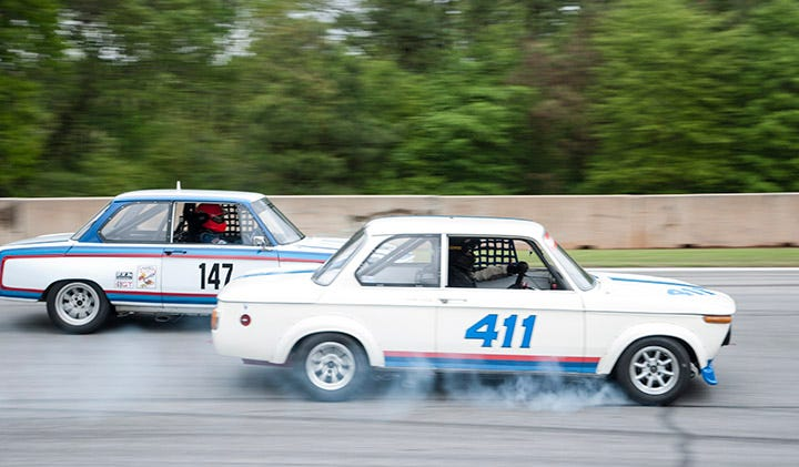 BMW 2002 mixing it up on Road Atlanta during Classic Motorsports Speedfest
