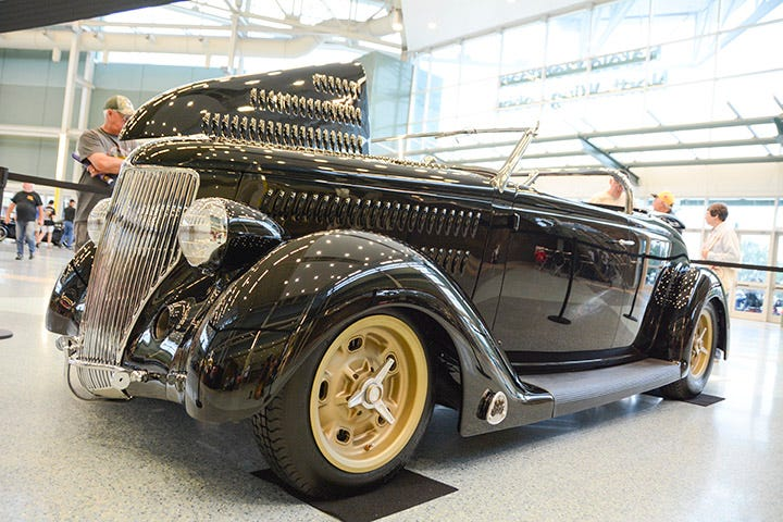 Tons of louvers and lots of race-inspired details make this '36 Ford roadster a standout wherever it goes. It was on display in the Builder's Showcase, and rolls on Excelsior radials.