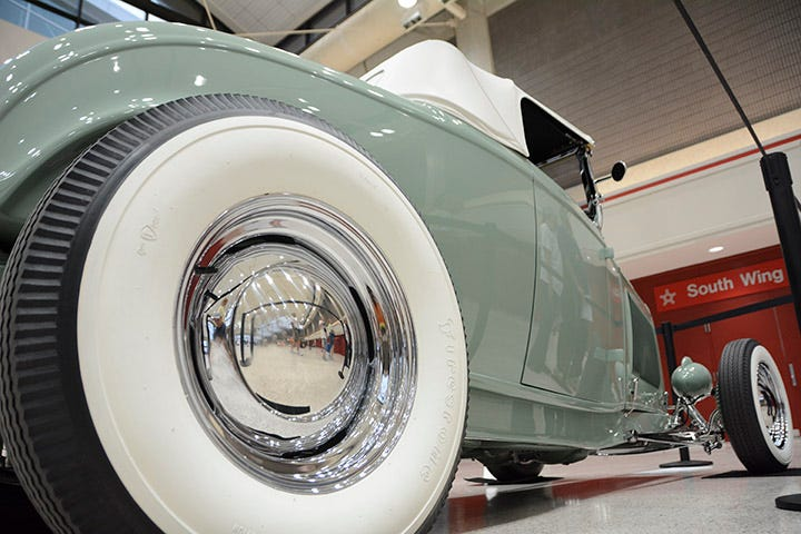 Whitewalls don't get much wider than this! Johnson's Hot Rod Shop built this pale green roadster, and chose a great combination with Firestone bias ply tires and chrome Hot Rod Steel wheels!