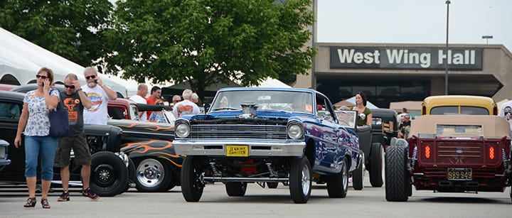 This was the scene at the 2015 NSRA Street Rod Nationals on Friday afternoon. A low slung roadster passes a wicked Chevy II gasser.