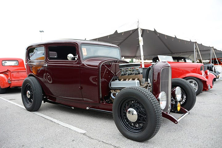 Excelsior Stahl Sport Radial tires and wire wheels are a nice fit for this maroon Deuce Tudor. The fenderless and hoodless sedan has a nice chop, and a multi-carbed Nailhead for power.