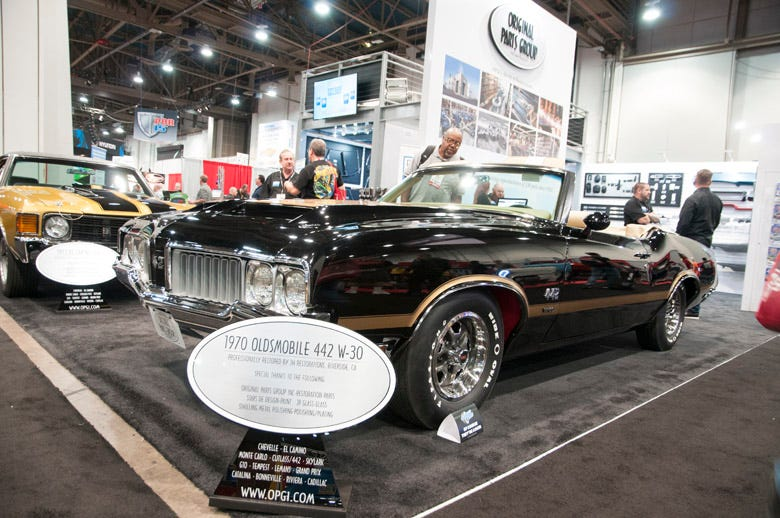 Original Parts Group always brings a couple of its muscle car restorations to display at the SEMA Show. This year has a black and gold theme, and this perfectly restored Olds 442 W-30 convertible is sporting Firestone Wide Ovals.