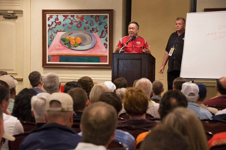 Coker Group President Wade Kawasaki addresses the crowd at the general meeting on Friday morning.